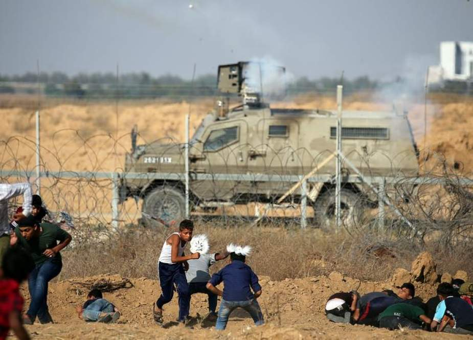 Israeli forces wound nearly 100 Gazan protesters