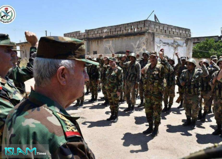 Defense Minister General Ali Abdullah Ayyoub visiting army soldiers in al-Hobeit, Idlib Province.