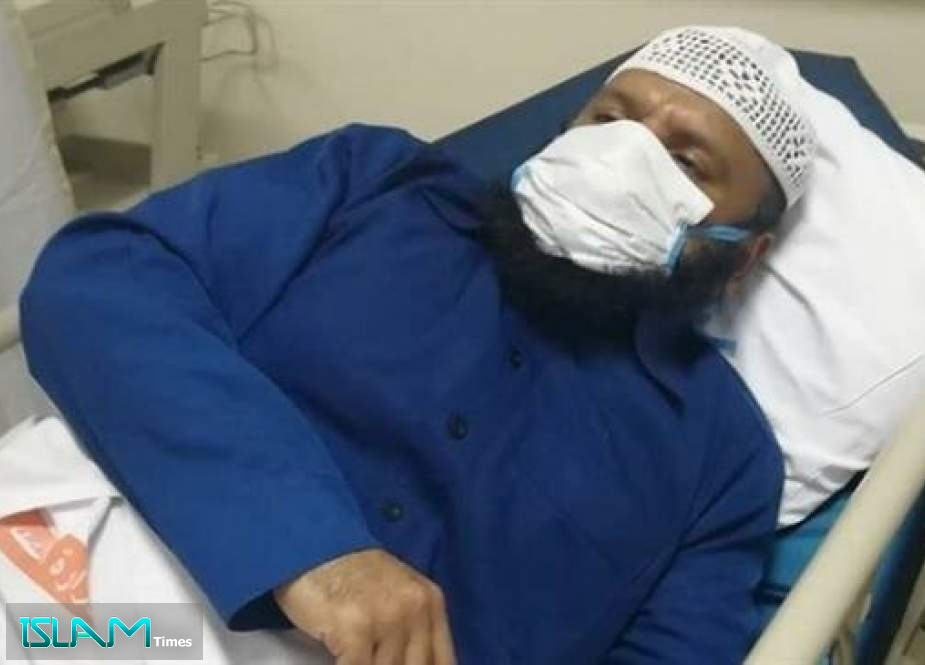 In this undated picture, former Bahraini lawmaker Osama Jaber Muhana al-Tamimi is lying on a bed at a hospital in Manama, Bahrain.