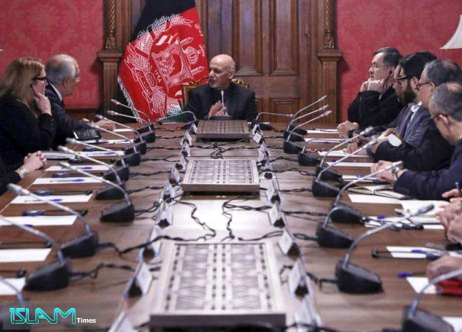 In this handout photograph taken and released by the Afghan Presidential Palace on January 27, 2019, Afghan President Ashraf Ghani (C) talks with US special representative for Afghan Peace and reconciliation Zalmay Khalilzad (top L) during a cabinet meeting at the presidential palace in Kabul.
