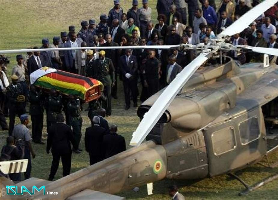 The coffin of former Zimbabwean President Robert Mugabe is carried to an awaiting helicopter to be flown back to the family residence after laying in state at the Rufaro Stadium in the capital Harare September13, 2019.