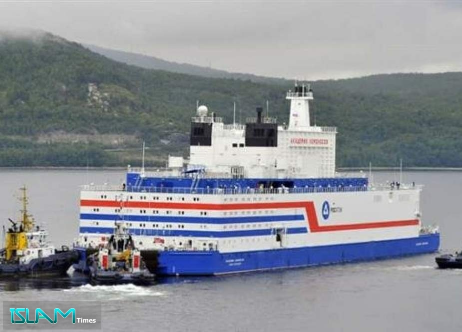 This handout picture taken and released on August 23, 2019 by the Russian nuclear agency Rosatom shows the floating power unit (FPU) Akademik Lomonosov being towed from the Arctic port of Murmansk, northwestern Russia.