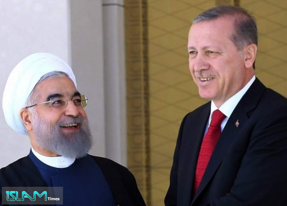 Iranian President Hassan Rouhani shakes hands with his Turkish counterpart Recep Tayyip Erdogan in Ankara
