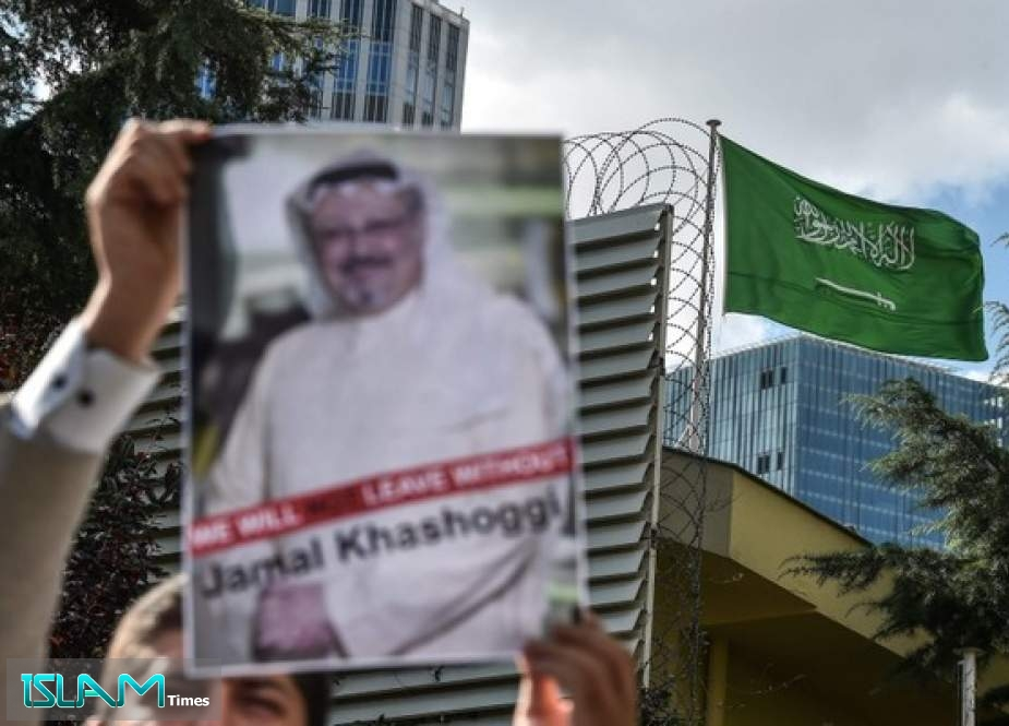 A protestor holds a picture of missing journalist Jamal Khashoggi during a demonstration