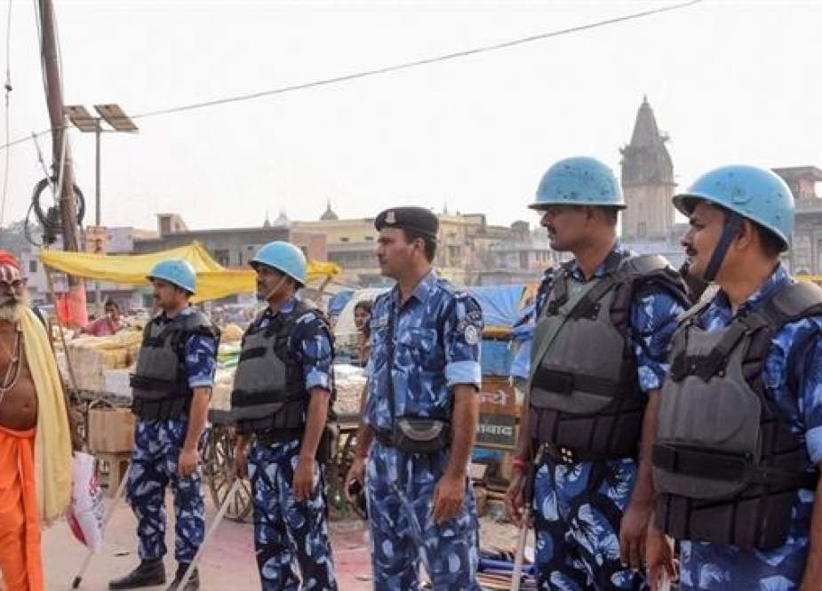 Security personnel stand guard on a street in Ayodhya.jpg