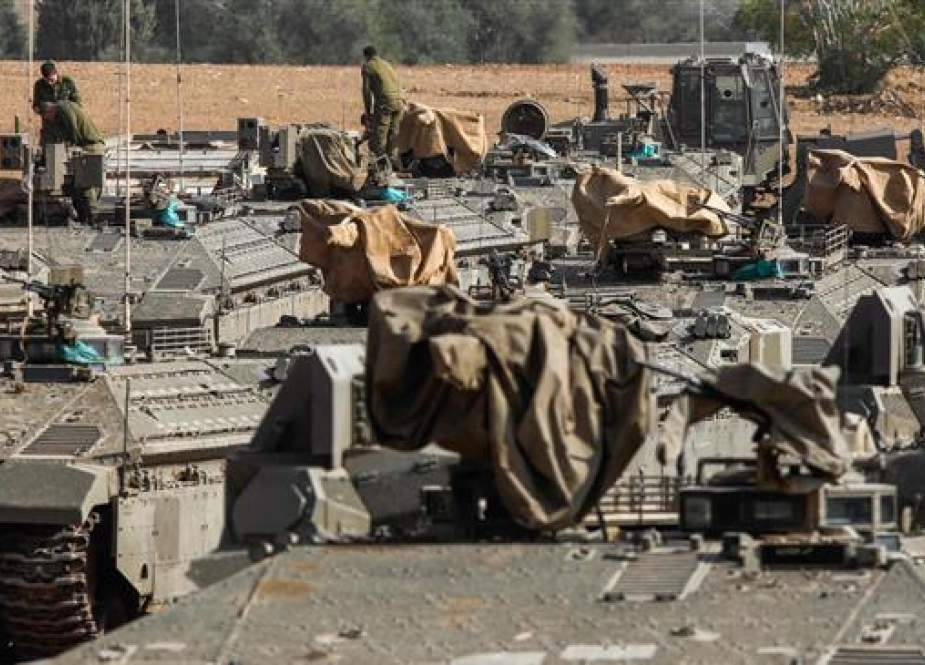 Israeli armored vehicles near the border with the Gaza Strip.jpg