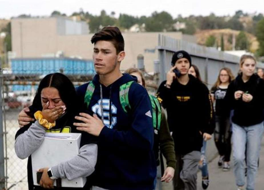 Students are escorted out of Saugus High School after reports of a shooting.jpg