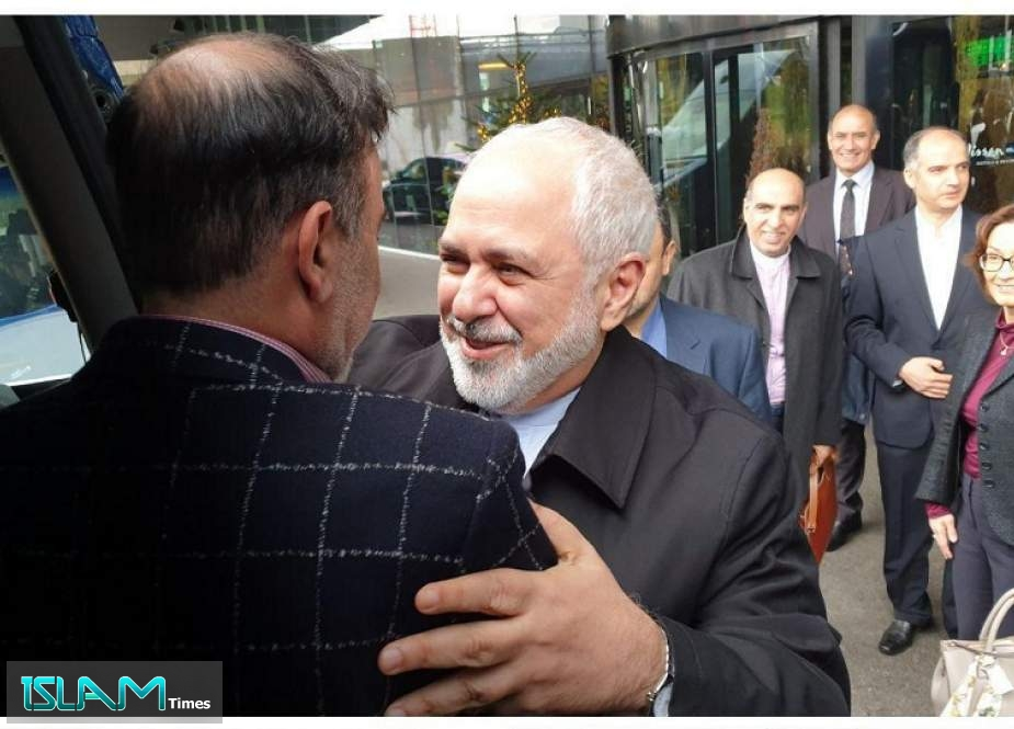 Iranian Foreign Minister Mohammad Javad Zarif Hugs cell scientist Masoud Soleimani who was freed after a year of imprisonment in the US.