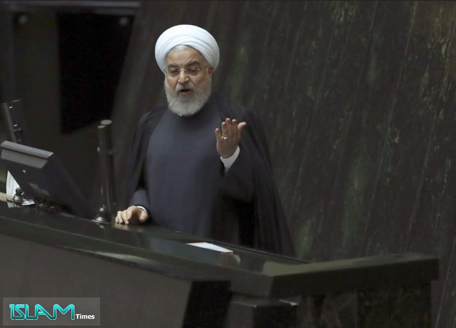 Iranian President Hassan Rouhani speaks while submitting next year