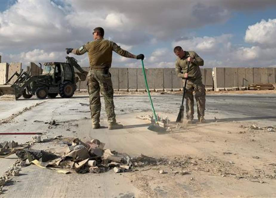US soldiers clearing rubble at Ain al-Asaad military airbase in the western Iraqi province of Anbar.jpg