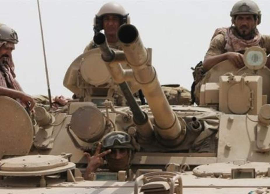Soldiers stand on a tank of the Saudi-led coalition.jpg