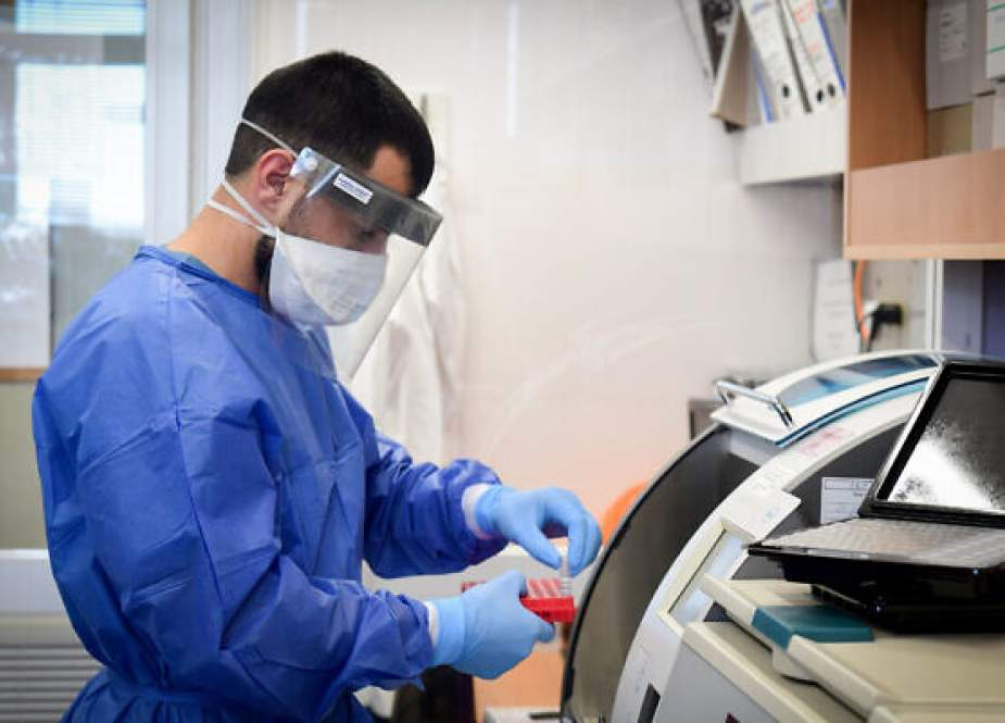 Israeli medical team member wearing protective gear at a hospital in the southern city of Ashkelon.jpg