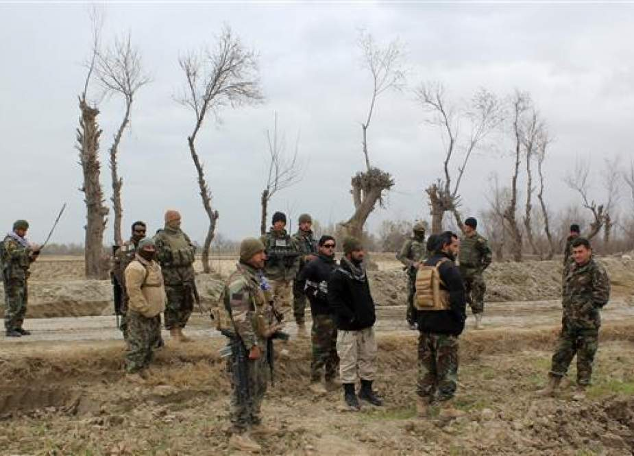 Afghan security forces are seen near an Afghan National Army (ANA) outpost in Kunduz Province.jpg