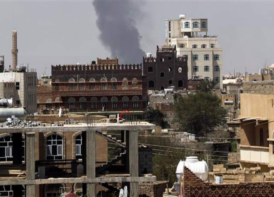 Smoke billows from the site of a Saudi-led airstrike in Sana, Yemen.jpg