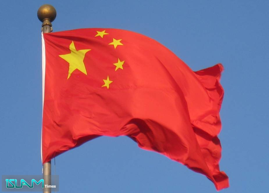 China Charges Two Canadians with Spying