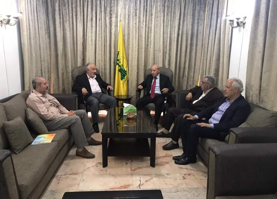 Head of Hezbollah Palestinian File Hasan Hoballah and the Hamas movement's representative in Lebanon Ahmad Abdul Hadi and delegation