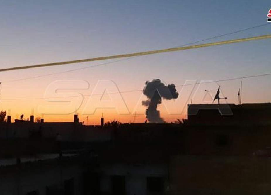 Smoke rising from an arms depot near SDF HQ in Syria
