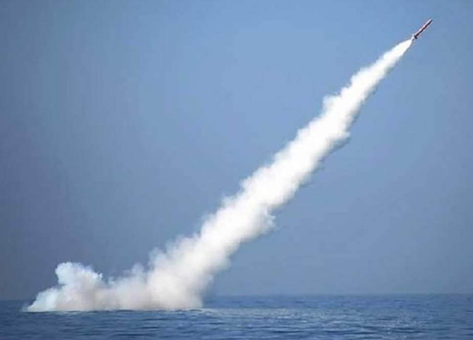 Iran's Navy launches submarine missile during war game.jpg