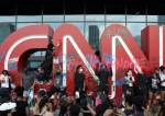 Protesters stand in front of a vandalized logo in front of the CNN Center in Atlanta, Georgia, US.JPG