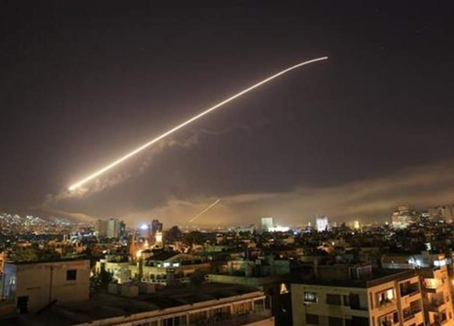 Damascus' sky lights up as the US launches attact.jpg