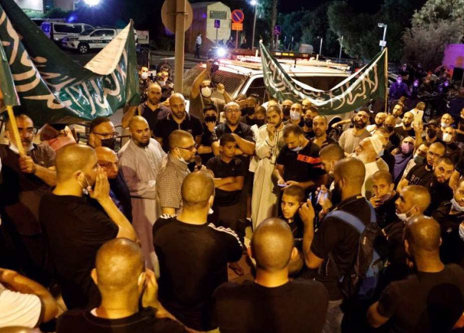 Palestinian protesters gather outside the residence of the French ambassador in Tel Aviv.jpg