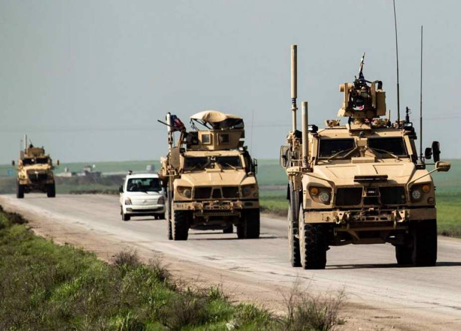 US occupation forces patrol the M4 highway.jpg