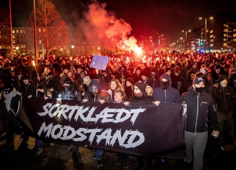 Anti-lockdown protesters march in Copenhagen, Denmark.jpg